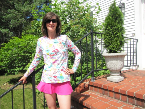 My new Lands End rash guard...I meant to get a shot of this while at the beach but got distracted...so here I am in all my bathing beauty glory on my parents' front steps...ha ha. (Lands End offers lots of other cute prints and bonus - looks like the tops are 50% off right now.)